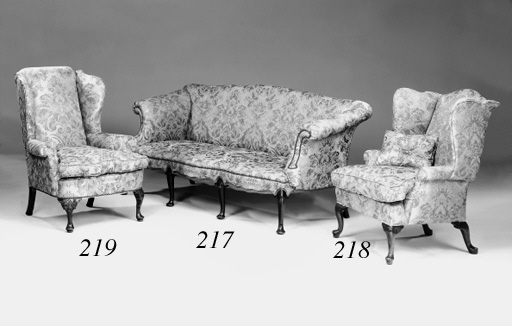 A walnut and upholstered wing armchair, early 20th century