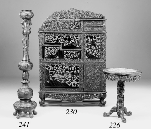 An Oriental carved hardwood shadona, early 20th century