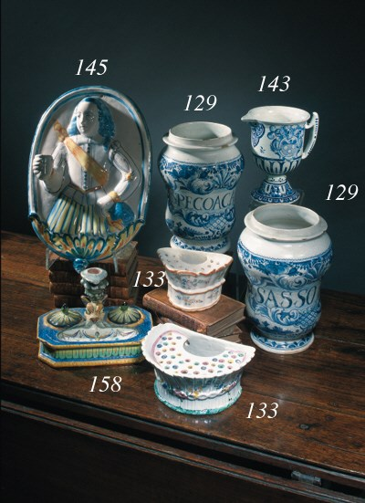A pair of faience blue and whi