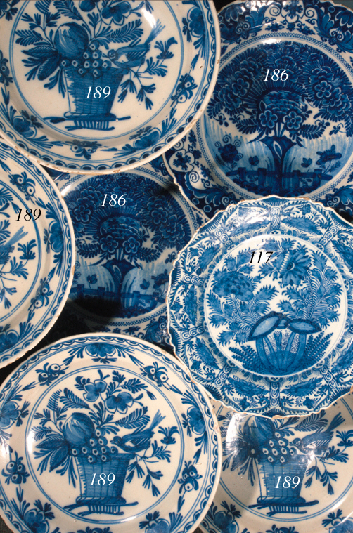 Four Delft blue and white dishes