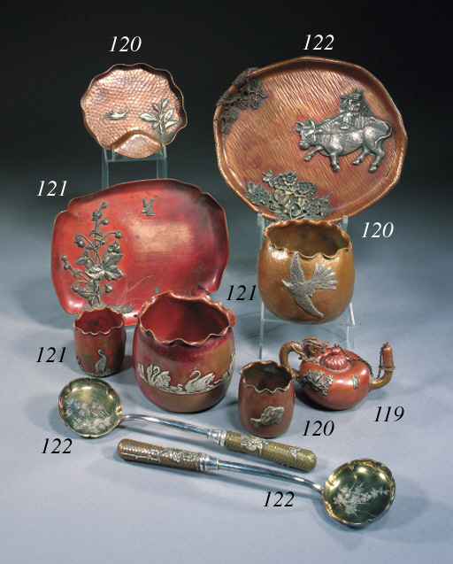 A GROUP OF PATINATED AND HAMMERED COPPER OBJECTS