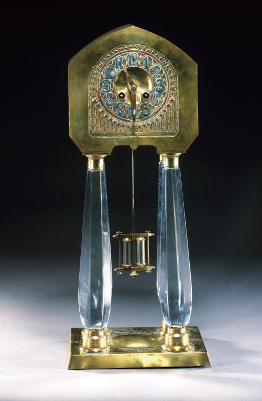 A BRASS AND CRYSTAL GLASS MANTEL CLOCK