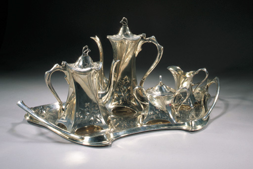A SILVERED METAL TEA AND COFFEE SERVICE