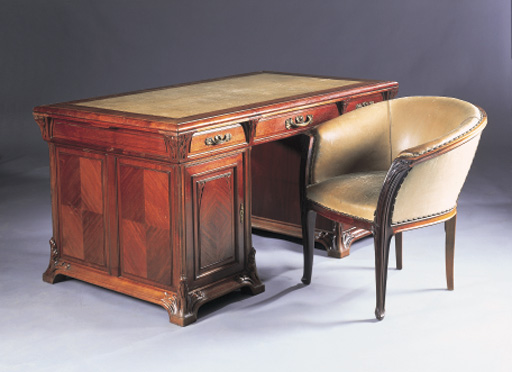 A CARVED MAHOGANY PEDESTAL DESK AND CHAIR MODELE LES ALGUES