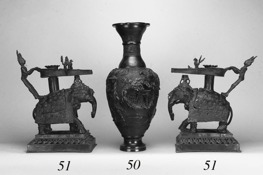 A pair of Indian bronze candle