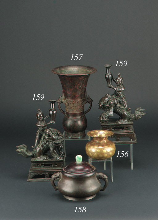 A pair of late Ming bronze inc