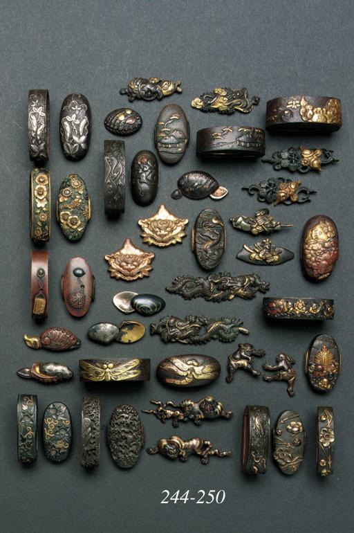 A pair of gilt-bronze menuki m