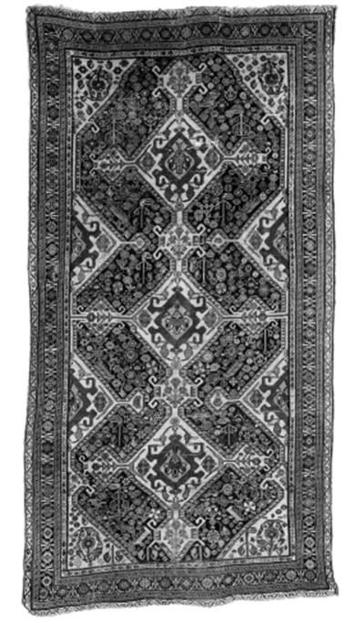 An antique Qashqai long rug