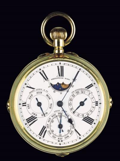 A gold open faced double dial