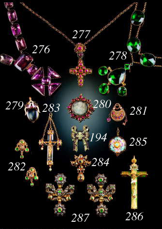 An antique gold and ruby cross