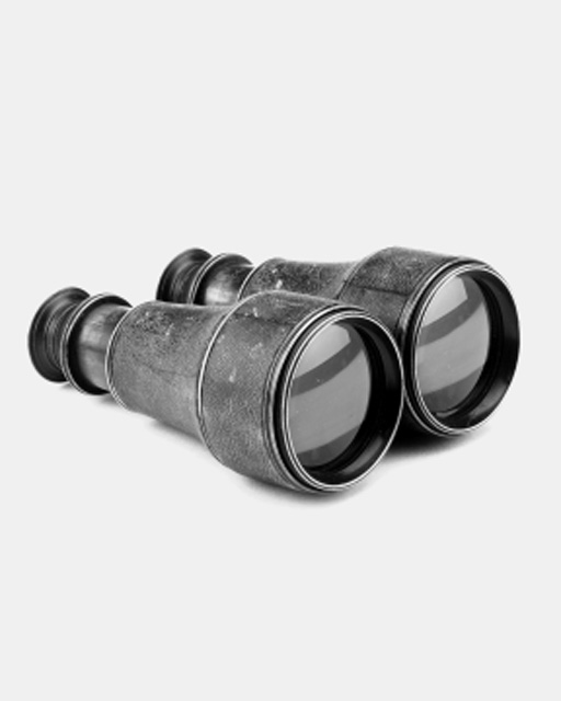 A pair of late 19th-Century oxidised-brass and leather-bound binoculars,