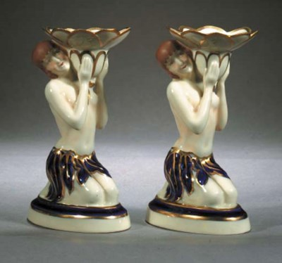 A pair of Royal Dux candlestic