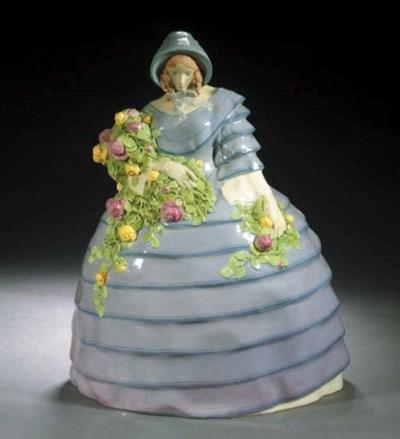 A WKW polychrome pottery figur