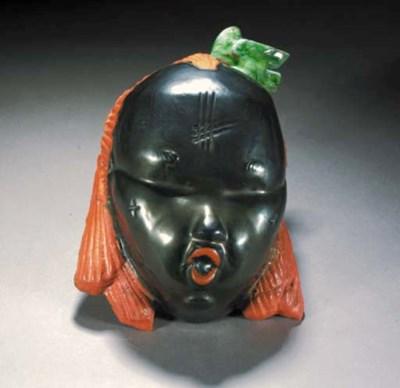 A polychrome pottery mask