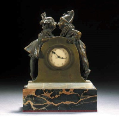 A patinated bronze clock