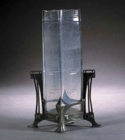 A W.M.F. glass and silvered me