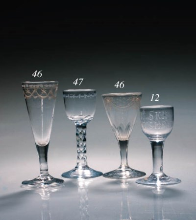 A pair of engraved wine flutes