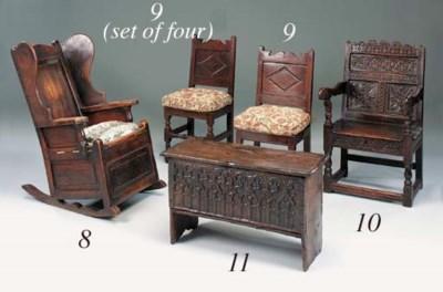 An oak rocking wing armchair,
