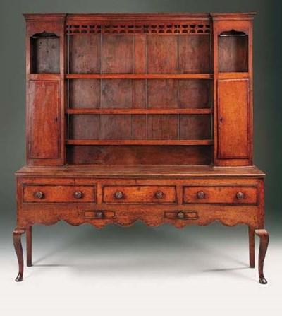 An oak and crossbanded dresser