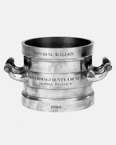 A bronze imperial gallon measu