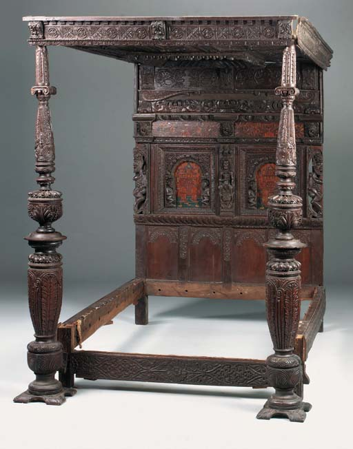 A carved oak and marquetry tes