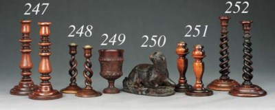 A pair of Victorian treen cand