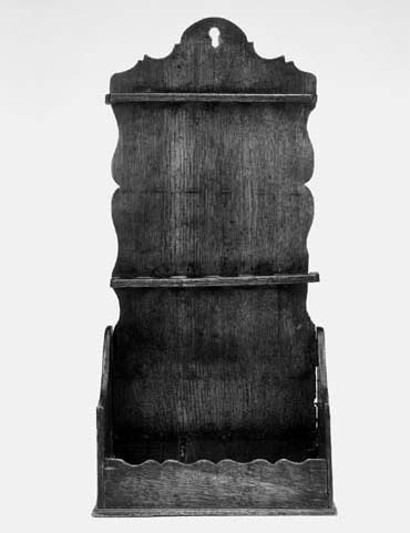 A Welsh oak combined spoon and candle rack, 18th century