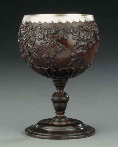 A carved coconut and treen sta