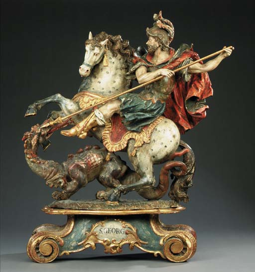 A large polychrome carved wood group of St George and the Dragon, probably South German, early 19th century