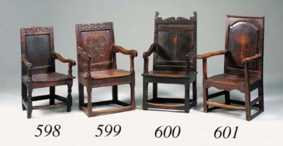 An oak panel back armchair, pr