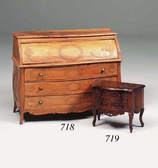 A Louis XVI style miniature serpentine fronted commode