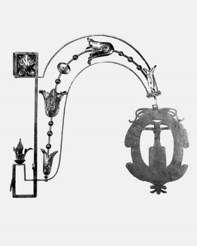 A wrought-iron vintner's sign,