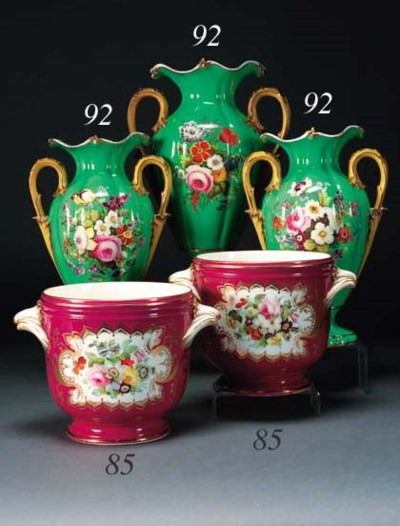 A pair of English porcelain cl