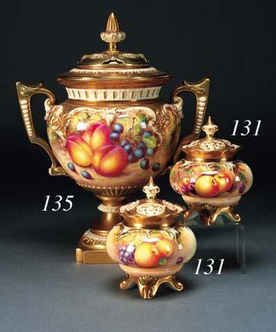 A pair of Royal Worcester compressed globular pot-pourri