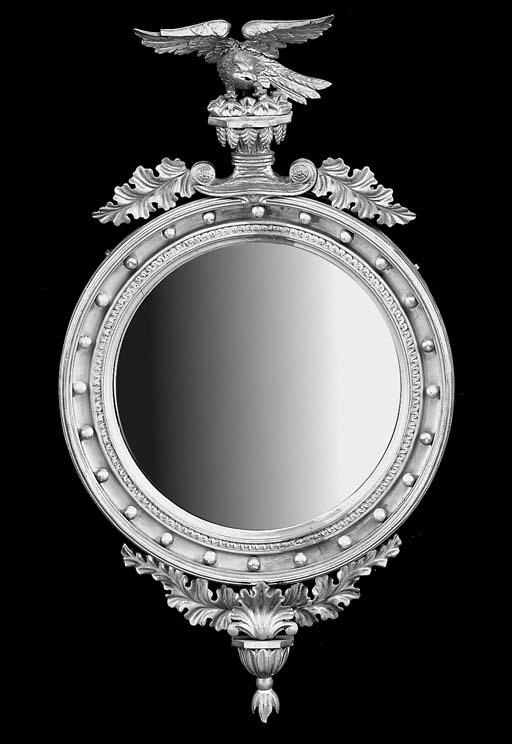 A gilt convex wall mirror, 19t