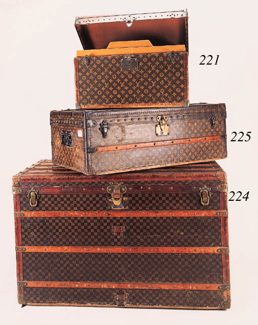 A Louis Vuitton trunk, covered