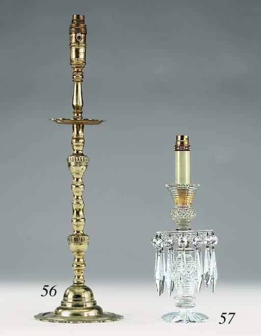 A pair of brass candlesticks,