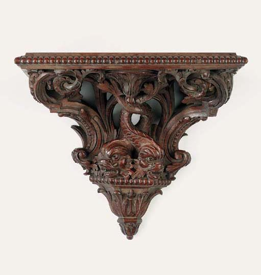 A pair of Continental carved w