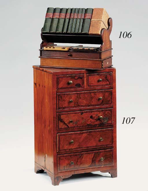 A Victorian walnut veneered an