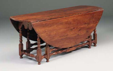 A yew-wood gate-leg table, 20t