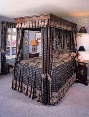 A mahogany four poster bed, 19