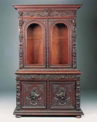A Victorian oak cabinet bookca