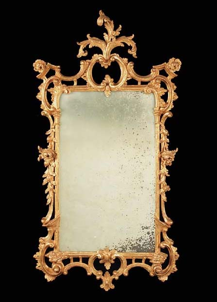 A carved giltwood mirror, 20th