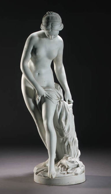 A Limoges biscuit porcelain figure of a bathing nymph