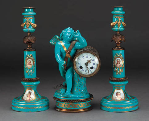 A pair of Sèvres style gilt-metal-mounted turquoise-glazed candlesticks