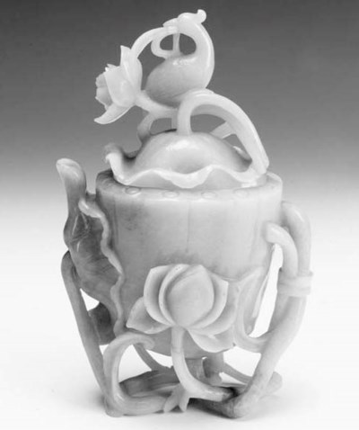 A Chinese jade ewer and cover