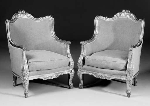 A pair of gilt and upholstered