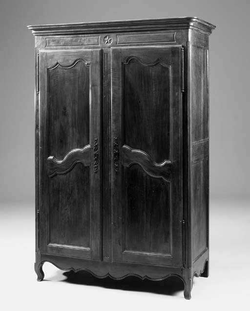 A fruitwood and oak armoire, l