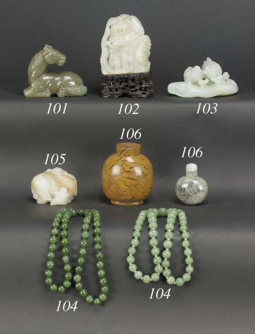 A Chinese pale celadon jade mo