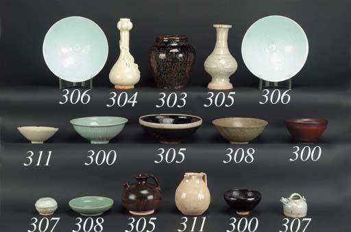A Temmoku glazed footed potter